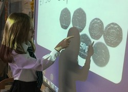 Kingfisher Class learn to add amounts of money