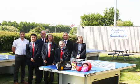 pinnacle-furniture-donate-sports-equipment-to-selsey-academy