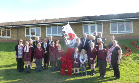 children-at-tkats-newlands-primary-school-unveil-albert-the-poppy-man-in-remembrance-day-service